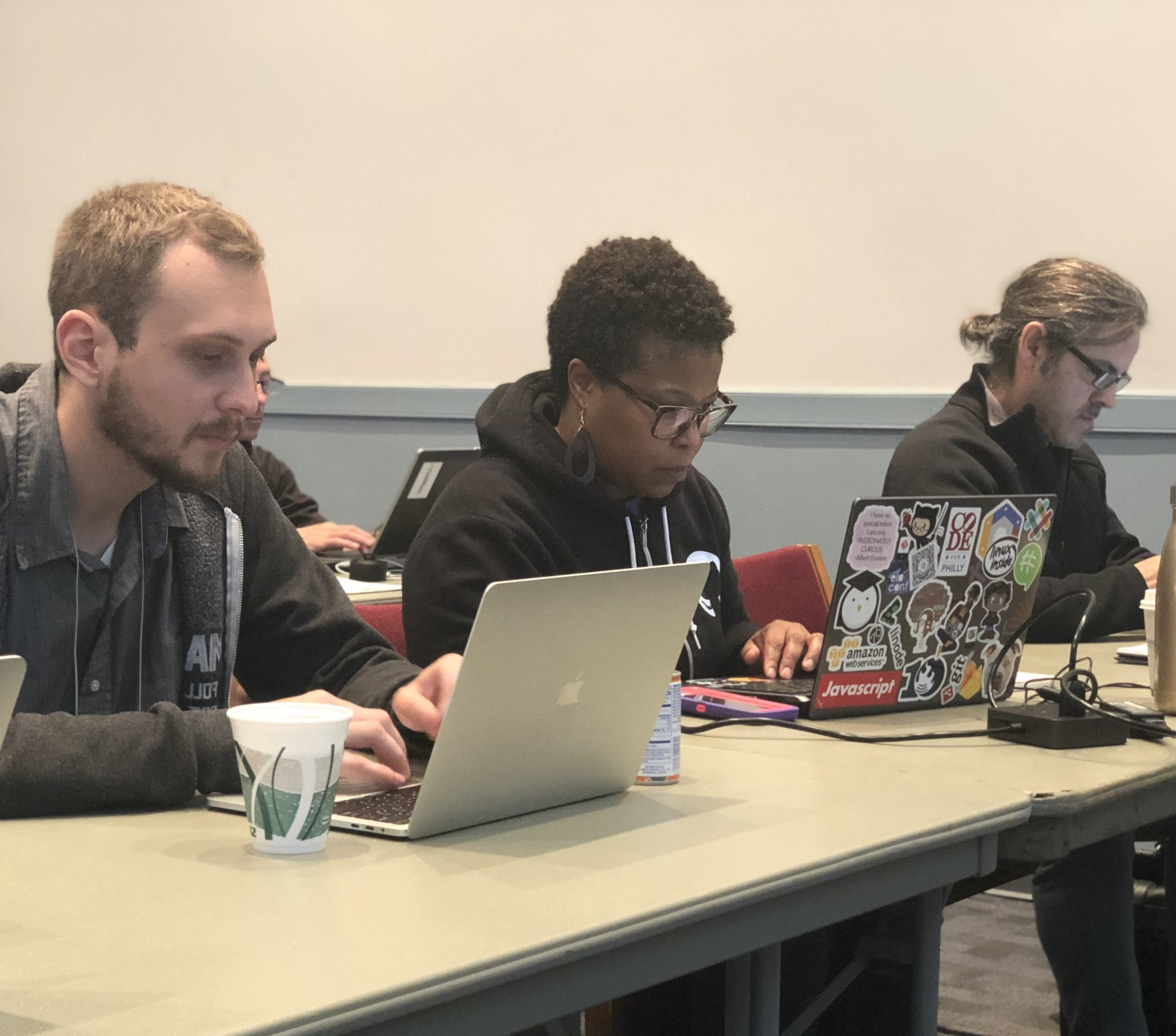 Three people participating in a workshop.