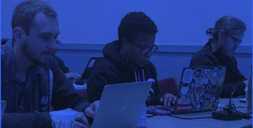 Close-up of three people at a software training session.